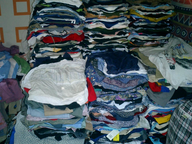 salvage new and return wholesale used clothing folded
